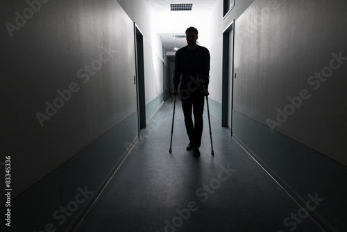 Poster Man Walking With Crutches