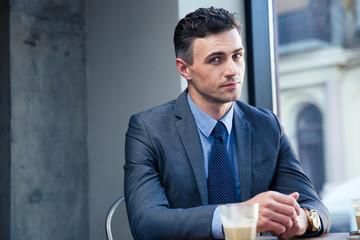Handsome businessman sitting in cafe