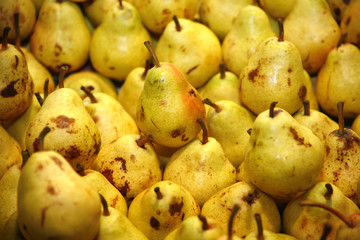 Freshly picked golden pears on retail market