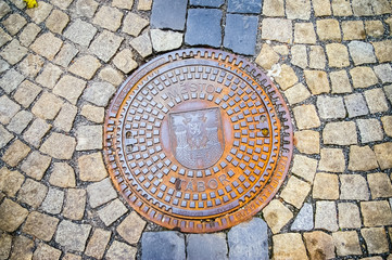 Hatch of sewage on the paving road
