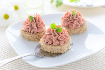 Festive snacks: canape with pate