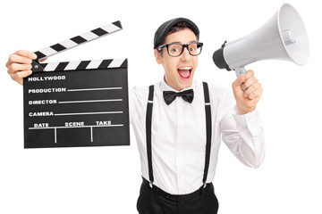 Young movie director speaking on a megaphone