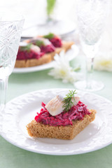 Canape with beetroot  and herring