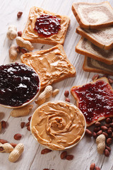 Toast with peanut butter and jelly close-up. vertical