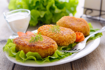 Dietetic carrots cutlets with white sauce