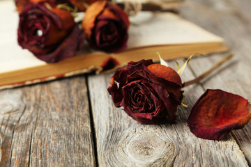 Dried roses on grey wooden background