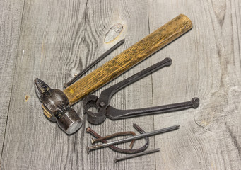 Old hammer, pincers and nails