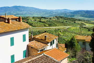 Countryside landscape with red roofs of houses.Toscana, Italy.