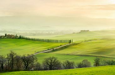 Landscape in foggy morning on sunrise. Tuscany, Italy