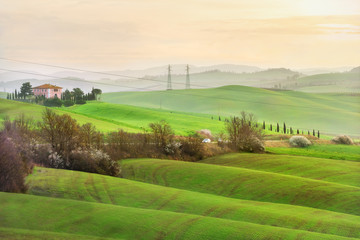 Countryside in Val d'Orcia province on sunrise. Tuscany, Italy