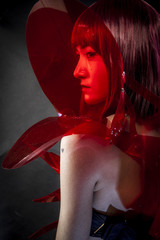 robot with red armor, beautiful young Japanese woman in a suit m