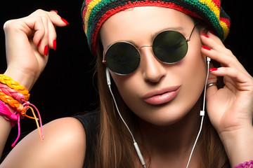 Fashionable Young Woman Enjoying Music Through Headphone