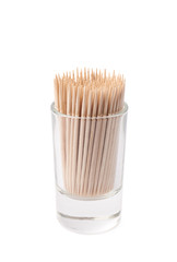 Glass shot filled with the toothpicks isolated