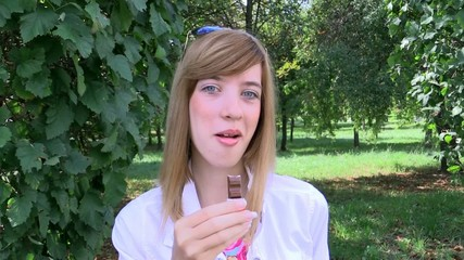 Pretty girl eating chocolate candy