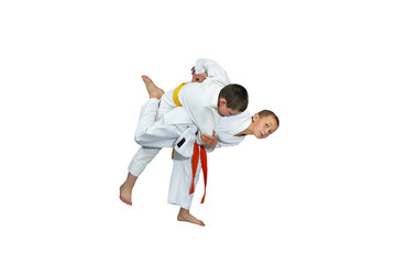 Children in judogi are doing the throws of judo