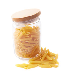 Glass jar filled with penne pasta isolated