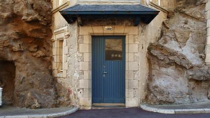 Round corner with blue door