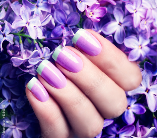 Manicured nails. Violet with green colors art manicure - 83363915