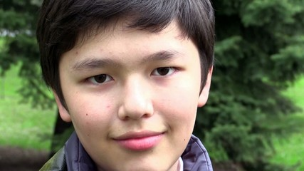 Close up portrait of Asian  boy smiling at the camera