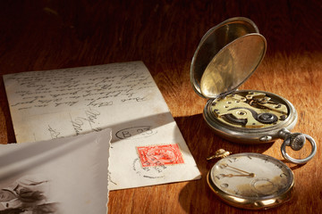 Old postcards and two pocket watches
