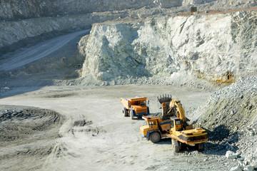 Big yellow trucks in quarry