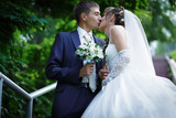 Bride and groom are kissing - 83365752