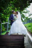 Bride and groom are kissing - 83365757