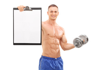 Handsome athlete holding barbell and a clipboard