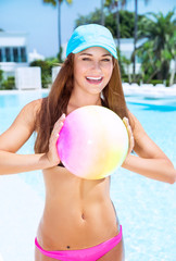 Happy woman playing with ball