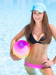 Sportive girl in swimming pool