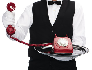 Butler with old telephone