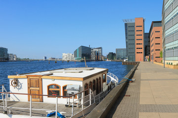 Boat, city channel, embankment. Copenhagen, Denmark