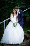 Groom kissing bride - 83370189