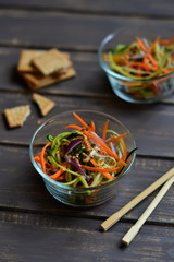 fresh salad with zucchini and carrots in an Asian style