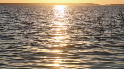 Sun track on lake water surface.