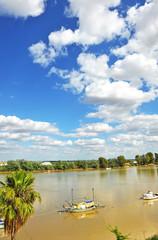 Guadalquivir River as it passes through Coria del Río, Spain