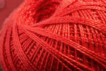 close up of skein of red thread