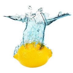 lemon falling in water on the white background
