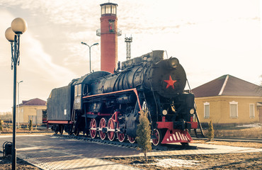 town decorations with the old steam locomotive and watchtower