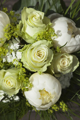 Detail of small bouquet with white roses for bride or bridesmaid