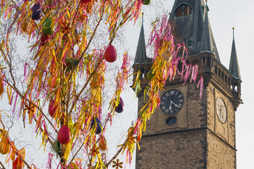Colorful Easter maypole in front of clock tower