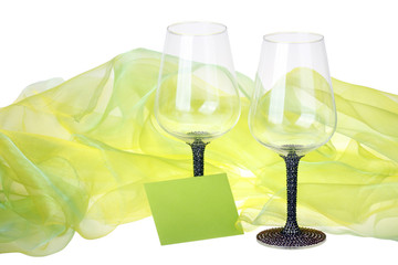 Close-up of two wine glasses with card and green velvet