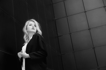 Fashion portrait of beautiful woman in trendy jacket over black