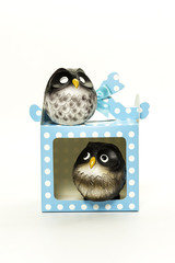 one resin owl in the gift box look at the other owl