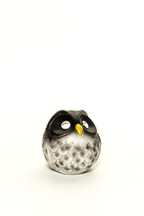One resin owl doll closed its eyes isolated on white background