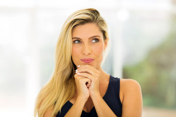 thoughtful young blonde woman