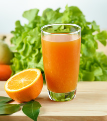 Orange juice in glass  on wooden background