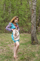 Young female Shaman in the forest with  bag.