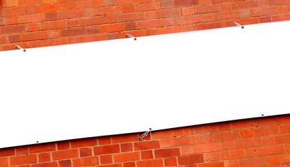 White banner against red brick wall
