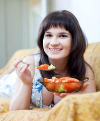 woman eats tomatoes salad